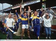 3 Spetember 1989; Tipperary players Michael Cleary, centre, and John Leahy, 2nd from right in tracksuit, celebrate their sides victory over Antrim at the final whustle. Tipperary v Antrim, All-Ireland Hurling Final, Croke Park, Dublin. Picture credit; Ray McManus / SPORTSFILE