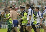 1 June 2003; Waterford's Fergal Hartley remonstrates with Referee Pat Aherne as he leaves the field under Garda escort. Guinness Munster Senior Hurling Championship, Limerick v Waterford, Semple Stadium, Thurles, Co. Tipperary. Picture credit; Brendan Moran / SPORTSFILE *EDI*