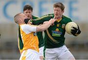 31 March 2013; Kevin Reilly, Meath, in action against Paddy Cunningham, Antrim. Allianz Football League, Division 3, Antrim v Meath, Casement Park, Belfast, Co. Antrim. Picture credit: Paul Mohan / SPORTSFILE