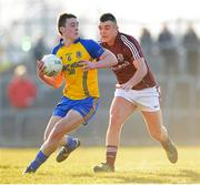 6 April 2013; John McManus, Roscommon, in action against Shane Maughan, Galway. Cadbury Connacht GAA Football Under 21 Championship Final, Roscommon v Galway, Dr. Hyde Park, Roscommon. Picture credit: Stephen McCarthy / SPORTSFILE