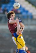 6 April 2013; James Shaughnessy, Galway, in action against Colin Compton, Roscommon. Cadbury Connacht GAA Football Under 21 Championship Final, Roscommon v Galway, Dr. Hyde Park, Roscommon. Picture credit: Stephen McCarthy / SPORTSFILE