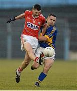 10 April 2013; Mark Surgue, Cork, in action against Paddy Dalton, Tipperary. Cadbury Munster GAA Football Under 21 Championship Final, Tipperary v Cork, Semple Stadium, Thurles, Co. Tipperary. Picture credit: Diarmuid Greene / SPORTSFILE