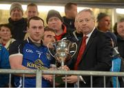 10 April 2013; Cavan captain Feargal Flanagan is presented with the Irish News Cup by Ulster GAA President Martin McAviney. Cadbury Ulster GAA Football Under 21 Championship Final, Cavan v Donegal, Brewster Park, Enniskillen, Co. Fermanagh. Picture credit: Oliver McVeigh / SPORTSFILE