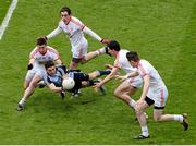 28 April 2013; Bernard Brogan, Dublin, in action against Tyrone players, from left, Patrick McNeice, Plunkett Kane, PJ Quinn and Conor Clarke. Allianz Football League Division 1 Final, Dublin v Tyrone, Croke Park, Dublin. Picture credit: Stephen McCarthy / SPORTSFILE
