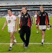 28 April 2013; A dejected Tyrone captain Stephen O'Neill, centre, who was injured in the warm up before the game, walks off after the game with PJ Quinn and Justin McMahon. Allianz Football League Division 1 Final, Dublin v Tyrone, Croke Park, Dublin. Picture credit: Oliver McVeigh / SPORTSFILE