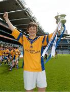30 April 2013; Fergal Ryan, captain of Scoil Treasa, Firhouse, Co. Dublin, celebrates with the cup after winning the Corn Aghais during the Allianz Cumann na mBunscol Finals. Croke Park, Dublin. Picture credit: Paul Mohan / SPORTSFILE