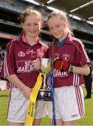 30 April 2013; Joint captains of Scoil Maelruain, Tallaght, Co. Dublin, Georgia Plowman, left, and Orlagh McGuigan, celebrate after winning the Corn Olly Quinlan at the Allianz Cumann na mBunscol Finals. Croke Park, Dublin. Picture credit: Paul Mohan / SPORTSFILE