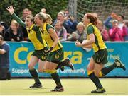 5 May 2013; Railway Union players, from left, Sinead Dooley, Kate McKenna and Emma Smyth celebrate after the game. Electric Ireland Irish Hockey League Women's Final, Loreto Hockey Club v Railway Union, Three Rock Rovers Hockey Club, Grange Road, Rathfarnham, Dublin. Picture credit: Pat Murphy / SPORTSFILE