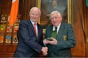 7 May 2013; Ireland's Olympic medallists from the London 2012 Olympic Games were presented with their International Olympic Committee lapel pins at a special ceremony in the Mansion House Dublin. Pictured is Tommy Murphy, President, IABA, on behalf of Michael Carruth, receiving the Olympic Council of Ireland Medal of Honour from Pat Hickey, President, Olympic Council of Ireland. Mansion House, Dublin. Picture credit: Brendan Moran / SPORTSFILE