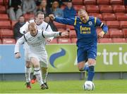 12 May 2013; Glen Madden, Bluebell United, in action against Michael Mulcrony and Karl Caulfield, behind, Avondale United. FAI Umbro Intermediate Cup Final, Bluebell United v Avondale United, Richmond Park, Dublin. Picture credit: Brian Lawless / SPORTSFILE