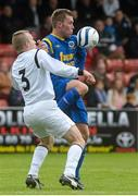 12 May 2013; Tony Griffith, Bluebell United, in action against David Spratt, Avondale United. FAI Umbro Intermediate Cup Final, Bluebell United v Avondale United, Richmond Park, Dublin. Picture credit: Brian Lawless / SPORTSFILE