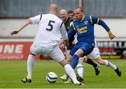 12 May 2013; Glen Madden, Bluebell United, in action against Mark Horgan, Avondale United.  FAI Umbro Intermediate Cup Final, Bluebell United v Avondale United, Richmond Park, Dublin. Picture credit: Brian Lawless / SPORTSFILE