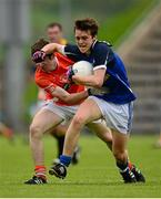 19 May 2013; Barry Fortune, Cavan, in action against Cathal McKenna, Armagh. Electric Ireland Ulster GAA Football Minor Championship, First Round, Cavan v Armagh, Kingspan Breffni Park, Cavan. Picture credit: Ray McManus / SPORTSFILE