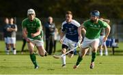 21 October 2017; Ben Conroy of Ireland, supported by team-mate Conor Lehane, in action against Craig Mainland of Scotland during the Shinty International match between Ireland and Scotland at Bught Park in Inverness, Scotland. Photo by Piaras Ó Mídheach/Sportsfile