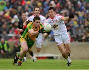 26 May 2013; Patrick McBrearty, Donegal, in action against PJ Quinn, Tyrone. Ulster GAA Football Senior Championship, Quarter-Final, Donegal v Tyrone, MacCumhaill Park, Ballybofey, Co. Donegal. Picture credit: Ray McManus / SPORTSFILE