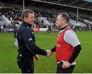 26 May 2013; Laois manager Justin McNulty congratulates his former Armagh team-mate and Louth manager Aidan O'Rourke, after the game. Leinster GAA Football Senior Championship, First Round, Laois v Louth, O'Moore Park, Portlaoise, Co. Laois. Picture credit: Dáire Brennan / SPORTSFILE