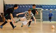 27 May 2013; Ian Byrne, Shamrock Rovers, is fouled by Rafael Souto, Eden College. FAI Futsal Cup Final, Shamrock Rovers v Eden College, National Basketball Arena, Tallaght, Dublin. Picture credit: Barry Cregg / SPORTSFILE