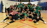 27 May 2013; The Eden College players celebrate with the cup after the game. FAI Futsal Cup Final, Shamrock Rovers v Eden College, National Basketball Arena, Tallaght, Dublin. Picture credit: Barry Cregg / SPORTSFILE