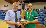 27 May 2013; Eden College captain Badr Bouznig, right, receives the cup from Noel Fitzroy, Vice-Chairman of FAI Junior Council, after the game. FAI Futsal Cup Final, Shamrock Rovers v Eden College, National Basketball Arena, Tallaght, Dublin. Picture credit: Barry Cregg / SPORTSFILE