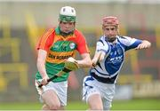 2 June 2013; Marty Kavanagh, Carlow, who will be starting his leaving cert on Wednesday in action against John Delaney, Laois. Leinster GAA Hurling Senior Championship, Quarter-Final, Laois v Carlow, O'Moore Park, Portlaoise, Co. Laois. Picture credit: Matt Browne / SPORTSFILE