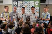 3 June 2013; Republic of Ireland players, from left, Sean St. Ledger, Stephen Kelly and Conor Sammon, faced tough questions from children, from left to right, Matthew Nolan, age 7, Katie Ewing, age 9, Freya Watts age 7, Mikey McHugh, age 10, Kyle McHugh, age 10 Levi Cuise O'Sullivan, age 7, Maurice Quinn, age 9, Cormac Nolan, age 8, Matthew Hanley, age 7, James Egan, age 8, and Gary Mooney, age 10, ahead of the Republic of Ireland v Faroe Islands World Cup qualifier on Friday. To see Three's 'Kids Press Conference' visit www.facebook.com/3Ireland. Portmarnock Hotel & Golf Links, Portmarnock, Co. Dublin. Picture credit: David Maher / SPORTSFILE