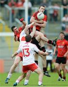 2 June 2013; Kalum King, Down, supported by Keith Quinn, in action against Ryan Bell and Benny Heron, Derry. Ulster GAA Football Senior Championship, Quarter-Final, Derry v Down, Celtic Park, Derry. Picture credit: Oliver McVeigh / SPORTSFILE