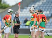 2 June 2013; Jack Kavanagh, Carlow, is sent off by referee Johnny Ryan as team-mates Marty Kavanagh,14, and Edward Coady,12, look on. Leinster GAA Hurling Senior Championship, Quarter-Final, Laois v Carlow, O'Moore Park, Portlaoise, Co. Laois. Picture credit: Matt Browne / SPORTSFILE