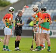 2 June 2013; Jack Kavanagh, Carlow, is sent off by referee Johnny Ryan as team-mates Marty Kavanagh, 14, and Edward Coady, 12, look on. Leinster GAA Hurling Senior Championship, Quarter-Final, Laois v Carlow, O'Moore Park, Portlaoise, Co. Laois. Picture credit: Matt Browne / SPORTSFILE