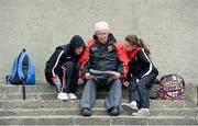 2 June 2013; Down supporters Malachy Sharvin, Kelief, Co Down, and his grand Children, 14 year old Eamon O'Hare and 11 year old Eimear Breen, reading the programme. Ulster GAA Football Senior Championship, Quarter-Final, Derry v Down, Celtic Park, Derry. Picture credit: Oliver McVeigh / SPORTSFILE