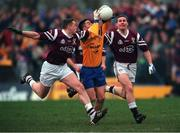 20 February 2000. Jason Sherlock, Na Fianna, in action against Liam Moffatt (left) and Damien Mulligan, Crossmolina.  Na Fianna v Crossmolina, AIB All Ireland Club Football Championship, Pearse Park, Longford. Picture credit; Ray Lohan/SPORTSFILE